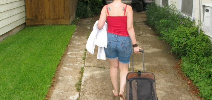 Image of Lady departing with her Essential Things to Pack for Travelling